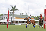 WELLINGTON, FL - MARCH 26:  Adolfo Cambiaso of Valiente and Gillian Johnston of Coca Cola (red jersey)watches the penalty shot on goal, as Valiente defeats Coca Cola 9-6 in the final of the 26 goal USPA Gold Cup, at the International Polo Club, Palm Beach on March 26, 2017 in Wellington, Florida. (Photo by Liz Lamont/Eclipse Sportswire/Getty Images)