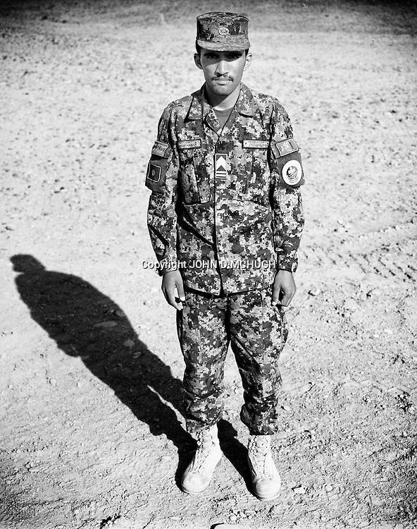 Sergeant Major Mir Agha, of the Afghan National Army, is seen at the Regional Military Training Centre in helmand, 12 November 2012. This portrait was shot on a 5x4 Linhof Technika IV, circa 1959, and a Voigtlander Braunschweig Heliar 15cm lens, circa 1922. (John D McHugh)