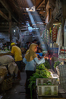 Jimbaran, Bali, Indonesia.  Woman Buying Vegetables in the Market.