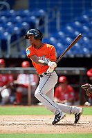 Miami Marlins Brayan Hernandez (23) follows through on a swing during a Florida Instructional League game against the Washington Nationals on September 26, 2018 at the Marlins Park in Miami, Florida.  (Mike Janes/Four Seam Images)