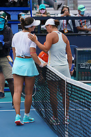 3rd April 2021; Miami Gardens, Miami, Florida, USA;  Bianca Andreescu (CAN), and Ashleigh Barty, (AUS) meet at center court after Barty's victory in the women's final of the Miami Open on April 3, 2021, at Hard Rock Stadium in Miami Gardens, Florida.