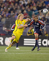 Columbus Crew forward Steven Lenhart (32) chases a pass as New England Revolution defender Darrius Barnes (25) defends. The Columbus Crew defeated the New England Revolution, 1-0, at Gillette Stadium on October 10, 2009.