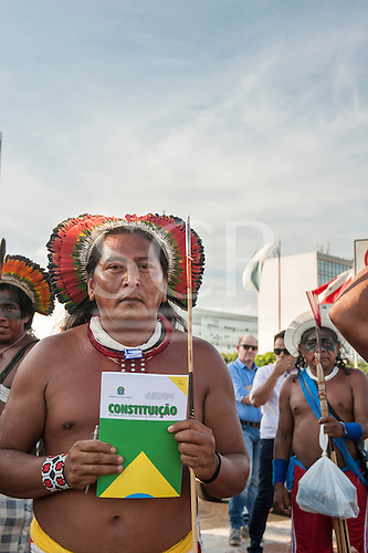 Bepnhoti Atydjare Kayapo holds a copy of the Brazilian Constitution during a demonstration in Brasilia, Brazil by the Xicrin, Kayapo and Pataxo tribes, 10th November 2015. Photo © Sue Cunningham, pictures@scphotographic.com