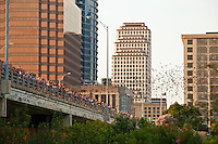 Thousands of onlookers gather on the Congress Avenue Bridge to watch the bats take evening flight as it shelters the largest urban bat colony in North America.