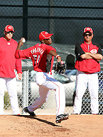 Aroldis Chapman, Cincinnati Reds pitcher in his first season after defecting from his native Cuba, pitches a bullpen session at the Reds training facility in Goodyear, AZ - 03/14/2010. Chapman is observed by Reds pitching coaches Bryan Price and Tony Fossas..Photo by:  Bill Mitchell/Four Seam Images.