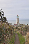 Historic North Head Lighthouse, Washington State.  Cape Disappointment.   Long Beach Peninsula, Washington State.  USA  Viewed from Lighthouse Keeper's pathway from home to lighthouse.