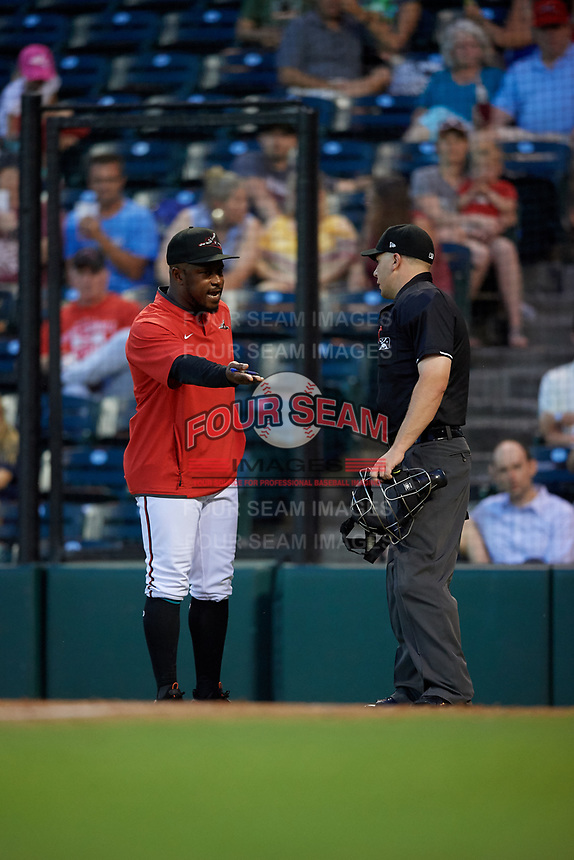 Richmond Flying Squirrels manager Willie Harris (22) argues a call with umpire Matt Carlyon during an Eastern League game against the Binghamton Rumble Ponies on May 29, 2019 at The Diamond in Richmond, Virginia.  Binghamton defeated Richmond 9-5 in ten innings.  (Mike Janes/Four Seam Images)
