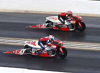 Jul 10, 2016; Joliet, IL, USA; NHRA pro stock motorcycle rider Hector Arana Sr (near) races alongside son Hector Arana Jr during the Route 66 Nationals at Route 66 Raceway. Mandatory Credit: Mark J. Rebilas-USA TODAY Sports