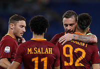 Calcio, Serie A: Roma vs Palermo. Roma, stadio Olimpico, 23 ottobre 2016.<br /> Roma's Stephan El Shaarawy, right, celebrates with teammates, from left, Francesco Totti, Mohamed Salah and Daniele De Rossi after scoring during the Italian Serie A football match between Roma and Palermo at Rome's Olympic stadium, 23 October 2016. Roma won 4-1.<br /> UPDATE IMAGES PRESS/Riccardo De Luca