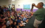 Gabe Kerschner, with Conservation Ambassadors, shows off Nike, a Kinkajou, during a presentation at the Boys & Girls Club of Western Nevada in Carson City, Nev., on Tuesday, June 12, 2018 as part of the Carson City Library's Summer Learning Challenge. <br /> Photo by Cathleen Allison/Nevada Momentum