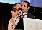 Keith Lind's daughter Avery speaks at the Holly's Angels Gala for Making Headway Foundation at Cipriani in New York City.   The benefit honored the memory of Holly Lind, Keith's wife and Avery's mother. Making Headway provides medical and social services for pediatric brain and spinal chord cancer patients and their families.