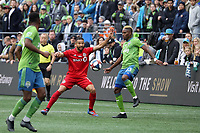 SEATTLE, WA - NOVEMBER 10: Joevin Jones #33 of the Seattle Sounders FC plays the ball in front of Justin Morrow #2 of Toronto FC during a game between Toronto FC and Seattle Sounders FC at CenturyLink Field on November 10, 2019 in Seattle, Washington.