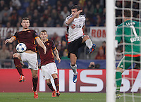 Calcio, Champions League, Gruppo E: Roma vs Bayer Leverkusen. Roma, stadio Olimpico, 4 novembre 2015.<br /> Roma's Edin Dzeko, left, is challenged by Bayer Leverkusen's Giulio Donati during a Champions League, Group E football match between Roma and Bayer Leverkusen, at Rome's Olympic stadium, 4 November 2015.<br /> UPDATE IMAGES PRESS/Isabella Bonotto