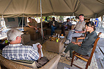 African Lion (Panthera leo) biologists, Jake Overton, Luke Hunter, and Kim Young-Overton, talking with trophy hunting managers about sustainability practices, Kafue National Park, Zambia