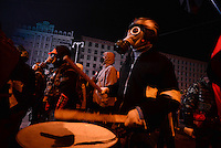 Protesters wearing gas masks march to  the rhythm of the war drums   during the   protest against new draconian law to ban the right to  protest across the country.  Kiev. Ukraine