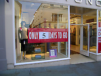 Countdown sign showing the number of days until the shop closes for good.