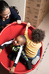 Education Preschool classroom scenes toddler-2s two boys working with on site occupational therapist