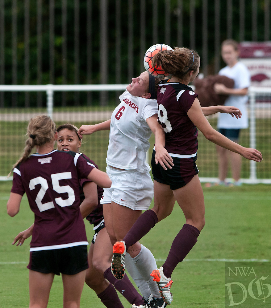 NWA Democrat-Gazette/BEN GOFF @NWABENGOFF<br /> Carly Hoke of Arkansas and Courtney Robicheaux of Mississippi State jump for a header on Sunday Sept. 20, 2015 during the match at Razorback Field in Fayetteville.