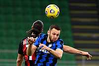 Football Soccer: Tim Cup Quarter Finals InternazionaleMIlan vs Milan, Giuseppe Meazza Stadium (San Siro) Milan, on January 26, 2021.<br /> Milan's Zlatan Ibrahimovic (l) in action with Inter's Stefan de Vrij (r) during the ItalianTim Cup football match between Inter  and Milan at the Giuseppe Meazza stadium in Milan, January 26, 2021.<br /> UPDATE IMAGES PRESS/Isabella Bonotto