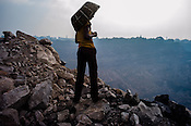 A scavanger stands on the edge of the hill looking over the Kujama Fire Project, an open cast mine in Jharia, outside of Dhanbad in Jharkhand, India.  Photo: Sanjit Das/Panos