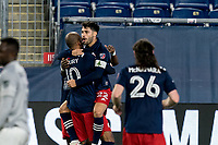 FOXBOROUGH, MA - NOVEMBER 20: Carles Gil #22 of New England Revolution celebrates his goal with teammates during the Audi 2020 MLS Cup Playoffs, Eastern Conference Play-In Round game between Montreal Impact and New England Revolution at Gillette Stadium on November 20, 2020 in Foxborough, Massachusetts.