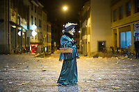 A masked participant in the Carnival of Basel, or Fasnacht, carries a basket on the last night of festivities. Basel, Switzerland. Feb. 26, 2015.