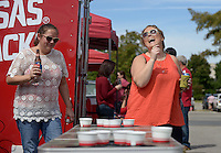 NWA Democrat-Gazette/BEN GOFF @NWABENGOFF<br /> Alison Bauxsein (left) and Mary Karsten of Fayetteville play beer pong on Saturday Sept. 19, 2015 while tailgating before the Arkansas football game against Texas Tech in Fayetteville.