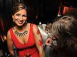 Jessica McPherson has her arm painted by Jeanette Arsement at the 14th Annual San Luis Salute at the Galveston Island Convention Center Friday Feb 28, 2014.(Dave Rossman photo)