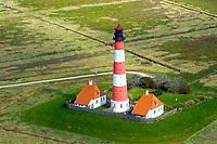 Leutturm Westerhever: DEUTSCHLAND, SCHLESWIG HOLSTEIN, 29.09.2010: Der Leuchtturm Westerheversand ist ein See-, Quermarken- und Leitfeuer. Die Feuerhöhe beträgt 41 Meter, die Bauwerkshöhe 40 Meter. Die Tragweite des Lichts ist rund 21 Seemeilen. Die indirekte Sichtbarkeit des Lichtscheins beträgt bis über 55 Kilometer. Bei klarer Sicht ist er noch auf Helgoland auszumachen.