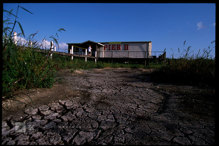 MAY 21, 2001. LAKE OKEECHOBEE, FLORIDA. Lake conditions are at about 9.5 three feet under average. Conditions are expected to get worse in the next few months. The PIER II in OKEECHOBEE is usually surrounded by water.