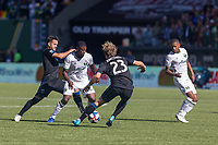 Portland, Oregon - Sunday October 6, 2019: Dairon Asprilla #27 takes on Valeri Qazaishvili #11 and Florian Jungwirth #23 during a regular season match between Portland Timbers and San Jose Earthquakes at Providence Park in Portland, Oregon.