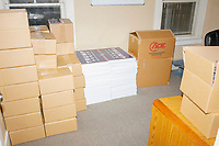 Boxes and stacks of Trump/Pence campaign signs are seen in a room in the office of the New Hampshire Republican State Committee in Concord, New Hampshire, on Wed., Sept. 16, 2020.