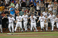 Members of the Virginia Cavaliers celebrate a walk-off victory during Game 4 of the 2014 Men's College World Series between the Virginia Cavaliers and Ole Miss Rebels at TD Ameritrade Park on June 15, 2014 in Omaha, Nebraska. (Brace Hemmelgarn/Four Seam Images)