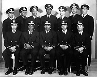 Group of recently appointed Negro officers.  Eleven of these men were recently appointed to the temporary rank of Ensign D-V(S), and one to Warrant Officer, USNR.  February 1944. (Navy)<br /> Exact Date Shot Unknown<br /> NARA FILE #:  080-G-300215<br /> WAR & CONFLICT BOOK #:  739
