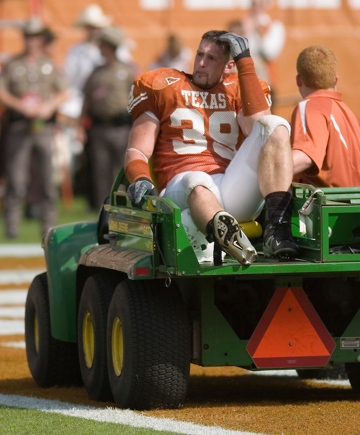 23 September 2006: Texas defensive end Brian Robison looks on after being injured during the Longhorns game against the Iowa State Cyclones at Darrell K Royal Memorial Stadium in Austin, TX.  Robison left the field on a medical cart under the care of team trainers.