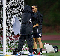 magicJack general manager Briana Scurry talks to goalkeeper Jill Loyden during warmups at Leslie C. Quick Jr. Stadium in Chester, PA. The game was cancelled due to weather.