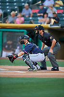 Joe Hudson (19) of the Salt Lake Bees in action against the El Paso Chihuahuas as umpire Ben May handles the calls behind the plate at Smith's Ballpark on July 5, 2018 in Salt Lake City, Utah. El Paso defeated Salt Lake 3-2. (Stephen Smith/Four Seam Images)
