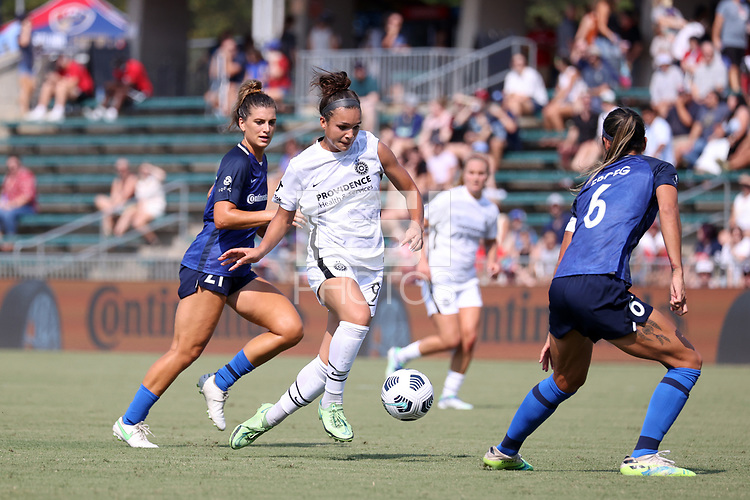 CARY, NC - SEPTEMBER 12: Sophia Smith #9 of the Portland Thorns FC moves between Cari Roccaro #21 and Abby Erceg #6 of the North Carolina Courage during a game between Portland Thorns FC and North Carolina Courage at Sahlen's Stadium at WakeMed Soccer Park on September 12, 2021 in Cary, North Carolina.