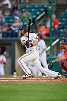 Rochester Red Wings second baseman Taylor Featherston (8) follows through on a swing in front of catcher Dan Butler (12) during a game against the Pawtucket Red Sox on May 19, 2018 at Frontier Field in Rochester, New York.  Rochester defeated Pawtucket 2-1.  (Mike Janes/Four Seam Images)
