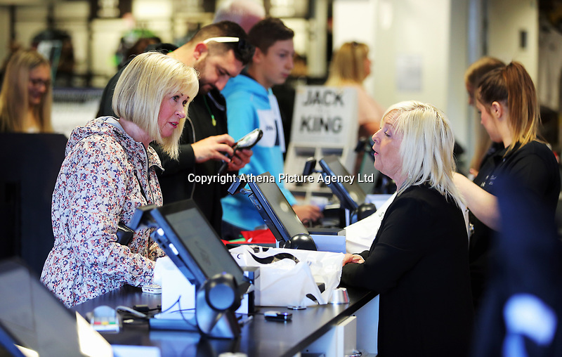 Pictured: A queue of shoppers for the tills. Saturday 01 July 2017<br /> Re: The new 2017-2018 season, Swansea City FC kit has officially gone on sale at the club's Liberty Stadium shop, Wales, UK