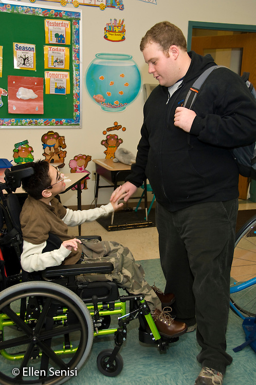 MR/Albany.Langan School at Center for Disability Services (private nonprofit disability services).Upper elementary classroom/Day Program.Teaching assistant holds hands with student after class. Boy: 11, cerebral palsy, expressive and receptive language delays.MR: Bro12, Woo2.© Ellen B. Senisi
