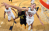 Dec. 17, 2010; Charlottesville, VA, USA; Virginia Cavaliers guard Joe Harris (12) defends Oregon Ducks guard Malcolm Armstead (11) at the basket during the game at the John Paul Jones Arena. Virginia won 63-48. Mandatory Credit: Andrew Shurtleff