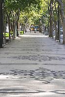 Street view. Avenida Liberdade. Tree lined walk. Lisbon, Portugal