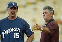 San Diego Padres Manager Bruce Bochy talks to Padres General Manager Kevin Towers during a 2003 season MLB game at Dodger Stadium in Los Angeles, California. (Larry Goren/Four Seam Images)