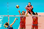 Xiangyu Gong (C) and Ni Yan of China (R) blocks Elina Rodriguez of Argentina (L) during the FIVB Volleyball Nations League Hong Kong match between China and Argentina on May 29, 2018 in Hong Kong, Hong Kong. Photo by Marcio Rodrigo Machado / Power Sport Images