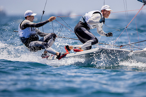 Robert Dickson (left) trapezing from his 49er dinghy with Sean Waddilove right