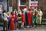 © Joel Goodman - 07973 332324 . 26/12/2015 . Wigan , UK . People queue at a cashpoint . Revellers in Wigan enjoy Boxing Day drinks and clubbing in Wigan Wallgate . In recent years a tradition has been established in which put on fancy dress for a Boxing Day night out . Photo credit : Joel Goodman