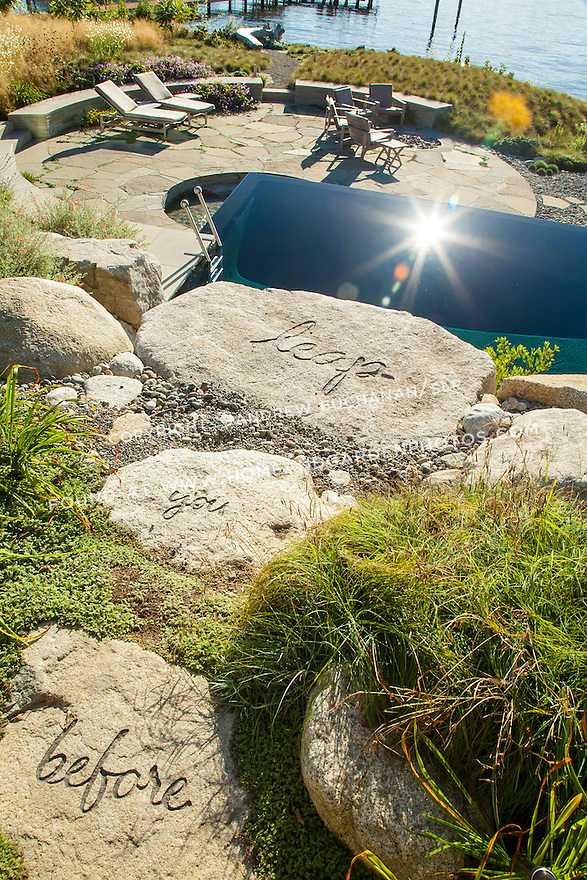 """Stones leading up to the infinity pool with the whimsical message, """"look before you leap"""""""