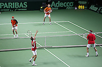 05-03-2005,Swiss,Freibourgh, Davis Cup , Swiss-Netherlands, Peter Wessels-Dennis van Scheppingen in action against Yves Allegro-George Bastl