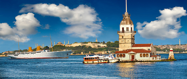 The Maiden's Tower Lighthouse at the mouth of the Bosphorus first built by the ancient Athenian general Alcibiades in 408 BC,  looking towrads from left, the Blue Mosque, Hagia Sophia & the Topkapi Palace on Sarayburnu or Seraglio Point , Istanbul Turkey.